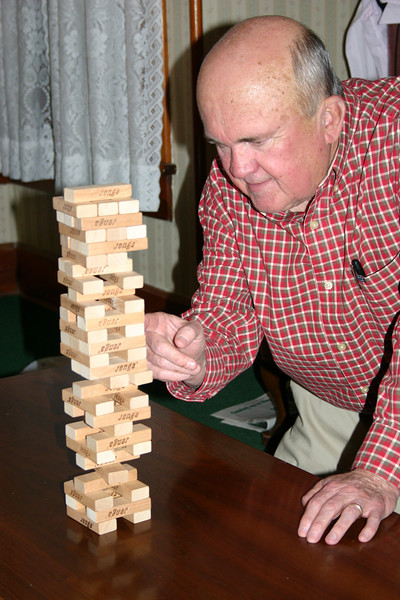 This is how it is done!  Bob participating in Jenga during our retreat in Eureka Springs, Arkansas.