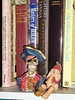 Not everyone has a pirate and a monkey with a fez on their bookshelves.