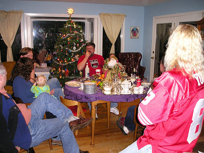 Friends gather around the food. (Paul, Linda, Cyrus' head,...Pete...Sharon's head)