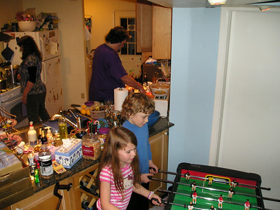 Alex and friends play foosball while Susan and Martin do massive food prep in the kitchen.