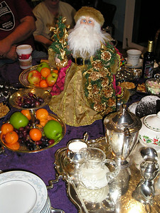 Table decor with Santa watching over all.