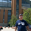 In front of the huge stadium with its giant baseballs