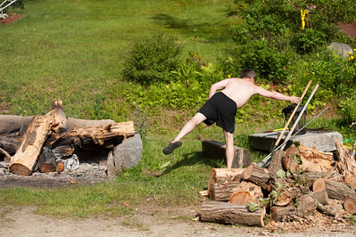 Brian tends the fire.