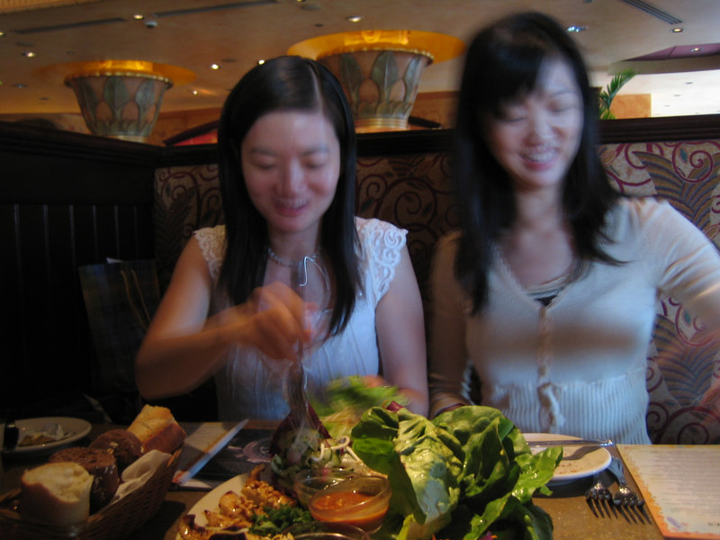 Jade and Carol chow down on some Thai chicken wraps. I get Thai chicken wraps sans chicken. :)