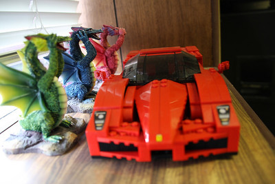 See no evil, hear no evil, speak no evil dragons watching over the greatness of the Lego Ferrari Enzo.