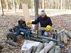 """""""Tricia at the controls of a gas-powered log splitter,"""" that's how."""