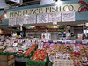 As the sign says...Pike Place Fish Co...fun watching fish fly through the air as it is ordered!
