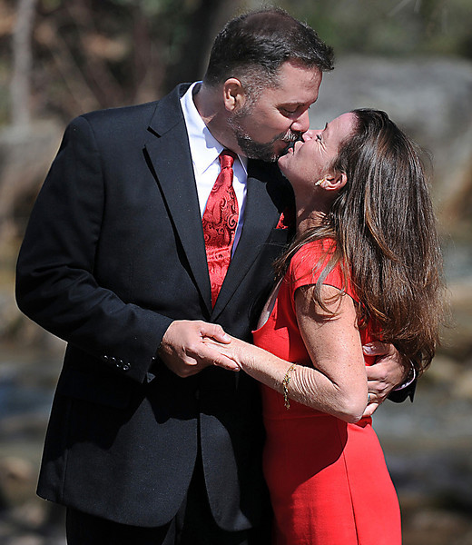 Kelly and Philip Cook renew their wedding vows at Falls Park in Greenville. The ceremony was witnessed by family and close friends.<br /> GWINN DAVIS PHOTOS<br /> gwinndavisphotos.com (website)<br /> (864) 915-0411 (cell)<br /> gwinndavis@gmail.com  (e-mail) <br /> Gwinn Davis (FaceBook)