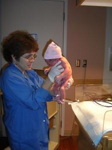 Nurse Jerrit holds up the baby bundle of joy!  She's so little!