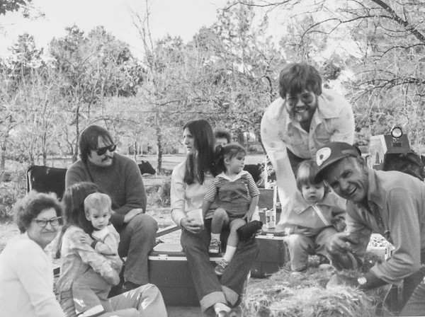 More of the same hayride, with Jack's friend Debbie sitting next to Steve, Jack tending to Heather, and Marvin Farmer in the forefront, far right, 1980ish.