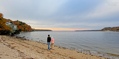 Couple walking along beach in Cold Spring Harbor.