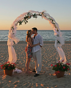 Couple kissing on beach at Sunken Meadow State Park.