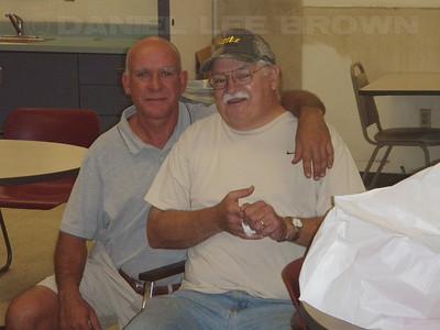Ralph Gwaltney's mini retirement bash! Santy and Ralphie.