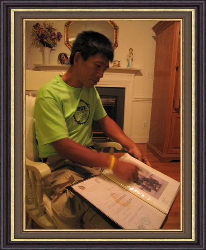 Daisuke showing scrapbook pictures, proclamations, and pictures [x-blackgold liner frame]