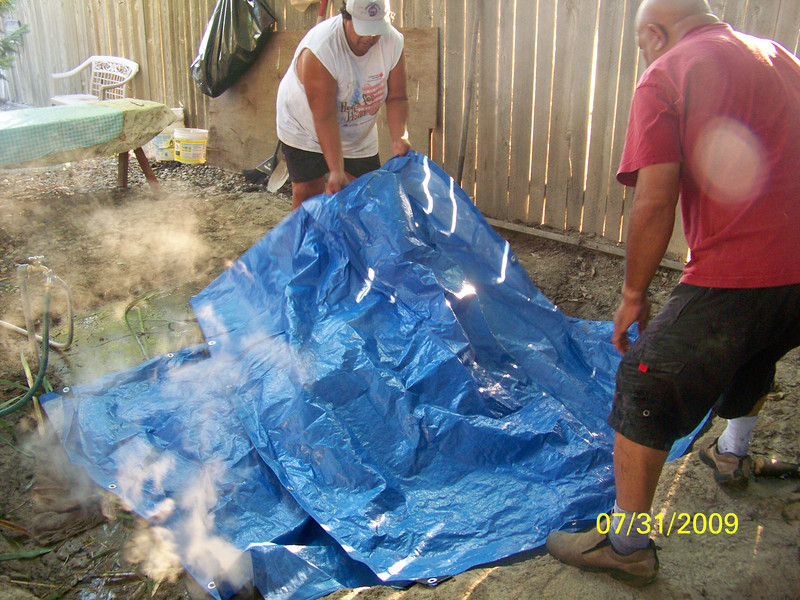 First layer of tarp to cover the burlap bags - to hold the steam in