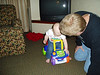 Dayton 3-08 -- Ethan checking out the new riding toy with Grandpa