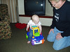 Dayton 3-08--Ethan checking out the new riding toy with Grandpa