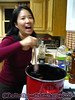 Angie stirring an extra ingredient into certain people's cider. (I think I can see it there in the background.)