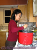 Angie stirring the apple cider.