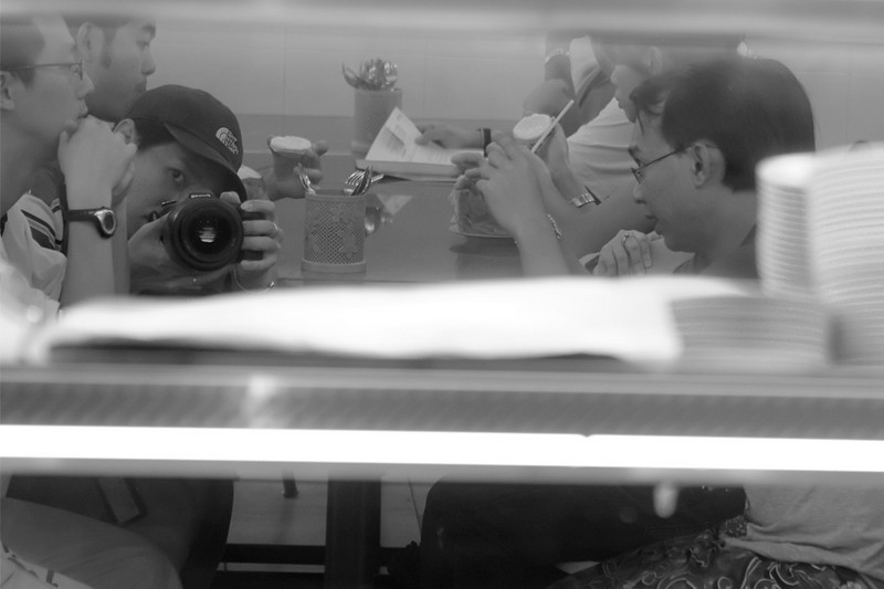 "Shooting the wall ""dark"" mirror. In frame: Me, Huang, Dennis, Tim, Janet and Merv's bracelet. At Rathaa restaurant."