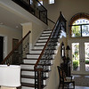 Gorgeous staircase with the front door to the right
