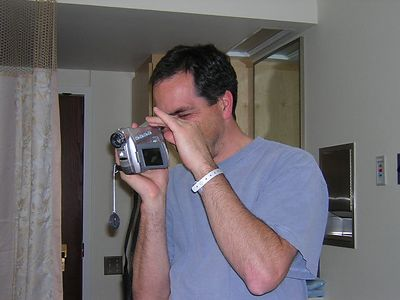 5-4-04 dad Peter videoing other people holding the little guy