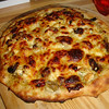 "Pizza cooked on the Big Green Egg, its a pizza oven too!   <a href=""http://www.greeneggers.com"">http://www.greeneggers.com</a>"
