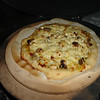 "Pizza not quite done on The Big Green Egg, and posted at <a href=""http://www.greeneggers.com"">http://www.greeneggers.com</a>"