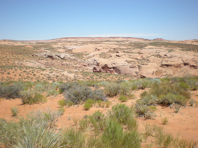 View from the trailhead down into the start of the canyon. What starts here as a shallow meander gets deeper and deeper, ultimately winding its way to dumping into Lake Powell at what used to be the Escalante River.