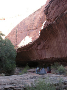 Shadow of Broken Bow Arch on the canyon wall.
