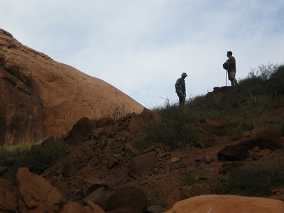 Silhouettes: Peter and Mark near Broken Bow Arch.