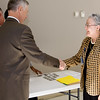 Associate Commissioned for Science Norris Alderson.  Photo by LT Loren Rodgers distributes FDA coins to honorees.  Photo by LT Loren Rodgers