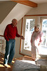 Knobby gives Helen tour of cottage