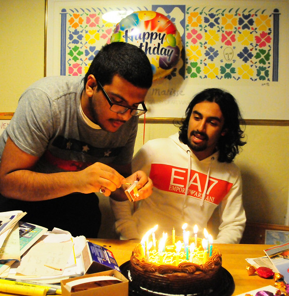 Fares lights the candles.  This is Aziz's first birthday cake!