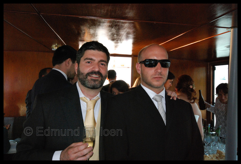 The Italian Groom and his German Bodyguard enjoying the finer things in life <br /> on the boat out to the island.
