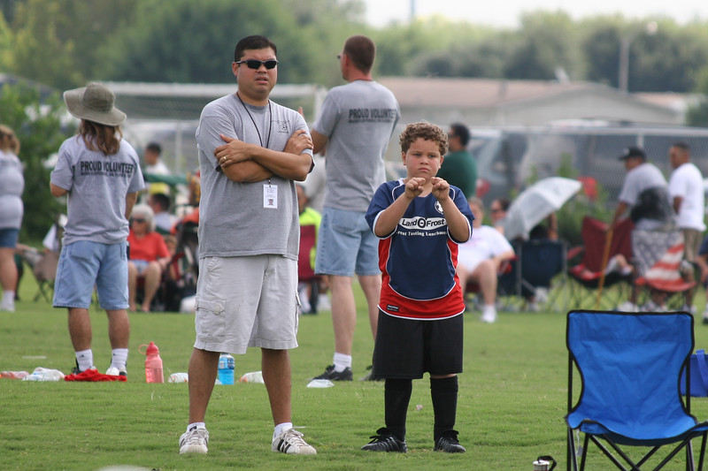 Ethan waiting with coach for the rest of the team.