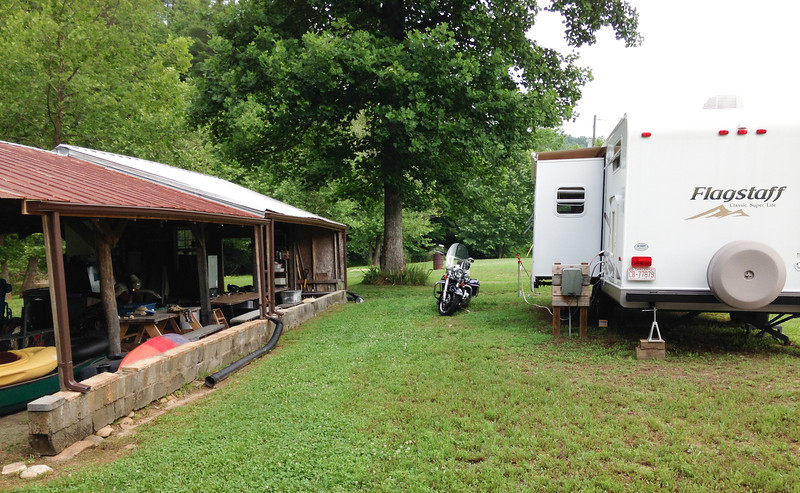 Larry's barn, my Harley rental, and trailer, June, 2014.