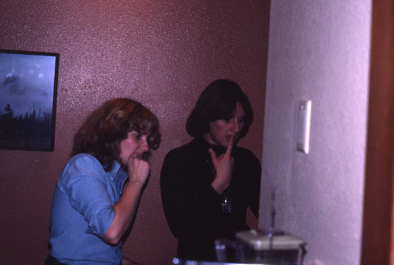 Marilyn and Ann trying to adjust the thermostat