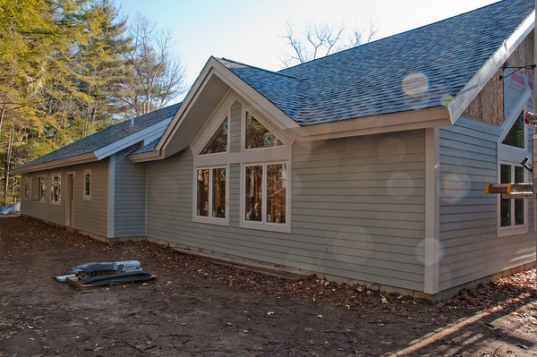 The back of the meetinghouse now has all of the siding and trim in place!
