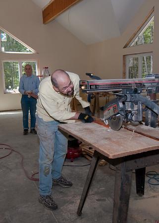 Greg & Jay ripping the trim for the worship room beams