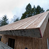 """Vertical strapping in place on top of the SIPs panels, to create a """"vented roof"""" space. One more layer of """"Advantech"""" sheathing goes on top of the strapping, then roofing."""