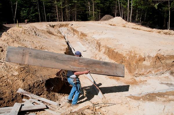 Ken Mounsey & Sons concrete crew begins placing footing forms.