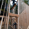 The framing crew works on the high interior bearing walls, up to the ridge!