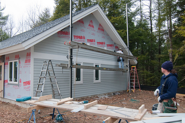 The Hardieplank siding (concrete clapboards invented by James Hardie) is installed on the east wall.