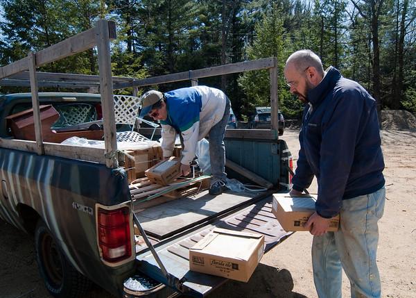 Deane & Greg unloading the tile