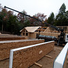 Multiple SIPs roof panels laid out and ready to lift into place.