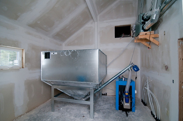 The pellet bin is complete and the furnace connected via the automatic auger pellet feed