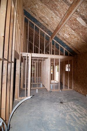 Mechanical room framed with storage platform above