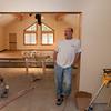Bill Luneau, about half-way through installing the worship room cork floor.