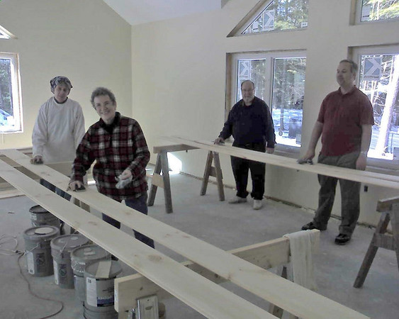 Sanding the beam trim: Here's the sanding crew around noon time.  Zane Knoy was out on an errand to get a broom and did a great job of sweeping up. Dave Woolpert photo